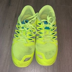 Neon green nike free tennis shoes